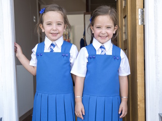 Formerly conjoined twins ready for school