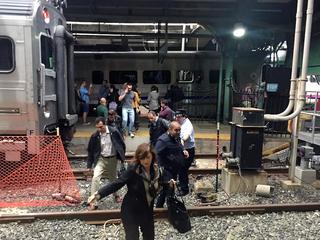 Photos: NJ commuter train crashes into station