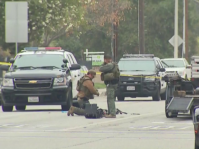 Pomona, California police officer shot dead as standoff with suspect continues